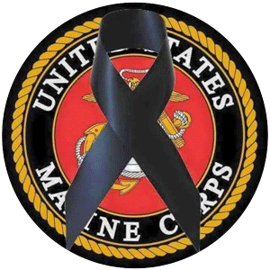 USMC badge with the black ribbon, symbolizing remembrance or mourning.