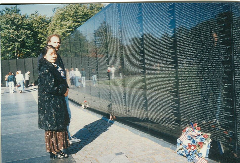 "Wayne Karlin and Le Minh Khue at the Vietnam Veterans Memorial Wall in Washington, D.C., 1993.                       Normal   0           false   false   false     EN-US   JA   X-NONE                                                                                                                                                                                                                                                                                                                                                                               /* Style Definitions */ table.MsoNormalTable 	{mso-style-name:""Table Normal""; 	mso-tstyle-rowband-size:0; 	mso-tstyle-colband-size:0; 	mso-style-noshow:yes; 	mso-style-priority:99; 	mso-style-parent:""""; 	mso-padding-alt:0in 5.4pt 0in 5.4pt; 	mso-para-margin:0in; 	mso-para-margin-bottom:.0001pt; 	mso-pagination:widow-orphan; 	font-size:12.0pt; 	font-family:""Avenir Book""; 	color:#2A2F3C;}       Wayne Karlin và Lê Minh Khuê tại bức tường tưởng niệm cựu chiến binh chiến tranh Việt Nam, ở Washington D.C., 1993"