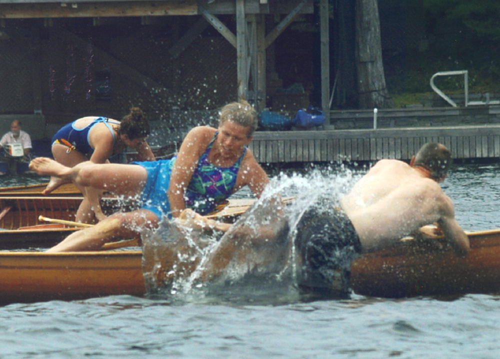 Bonnie competes in a canoe race in which racers have to jump out of the canoe and get back in it before they can finish.