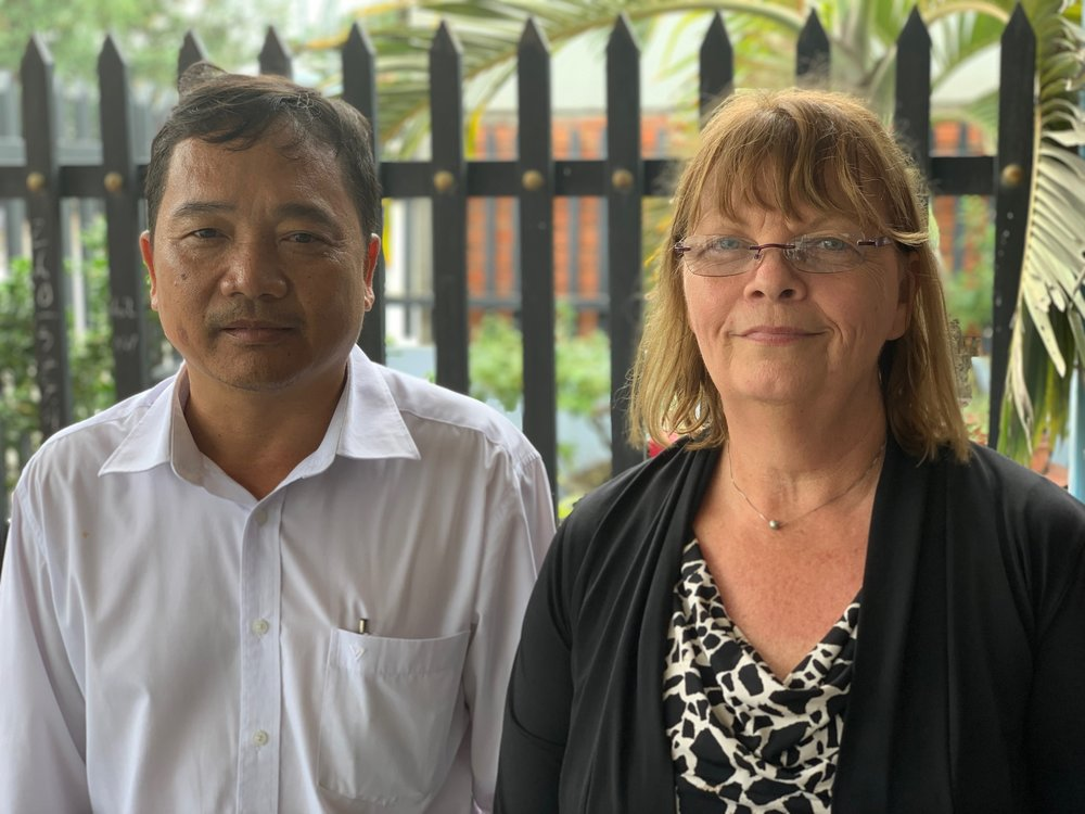 "Nguyen Hoang Giang and Jill Hubbs, whose  fathers died fighting on opposite sides of the Vietnam/American War. Giang's father, an educator, was killed in 1967 when Giang was two years old. Giang's uncle and grandfather also died during the war. Today Giang is an educator who believes ""we should do all in our ability to maintain peace for both sides."" Jill is an educator too. Herfather's plane crashed into the Gulf of Tonkin in March 1968. To this day he remains missing in action. ""In Vietnam  I have met people who fought and who lost on the opposite side of the war, and they are all gracious and friendly toward me. It's been an amazing experience to connect with them."""