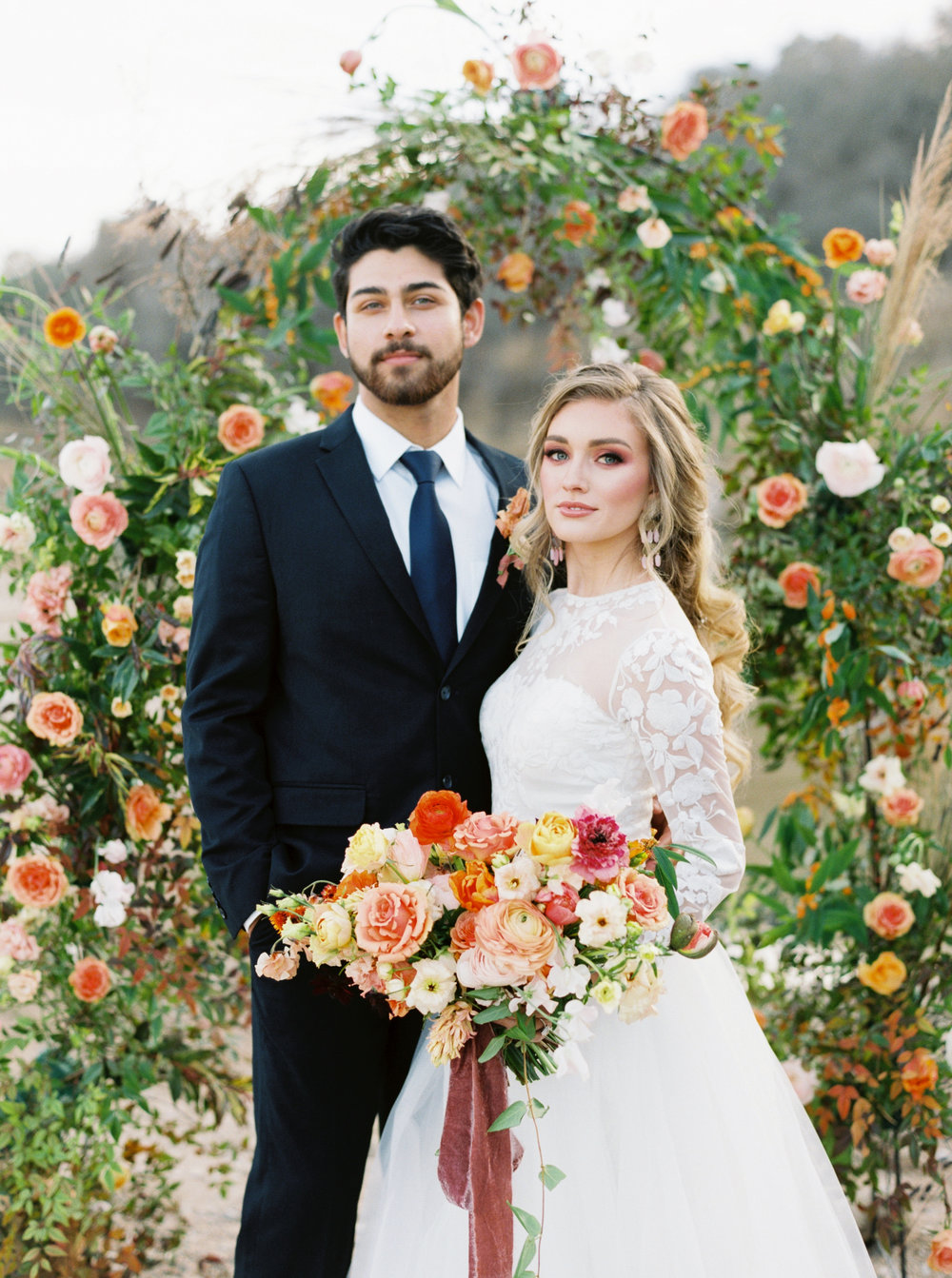 Austin Bride with Bouquet and Groom at Floral Arch
