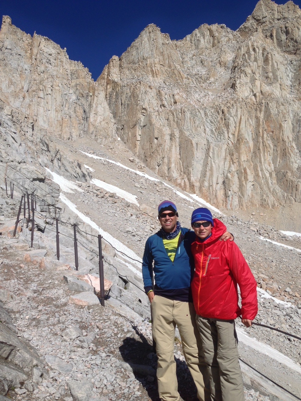 fletcher climbing to the top of Mt. Whitney with his son
