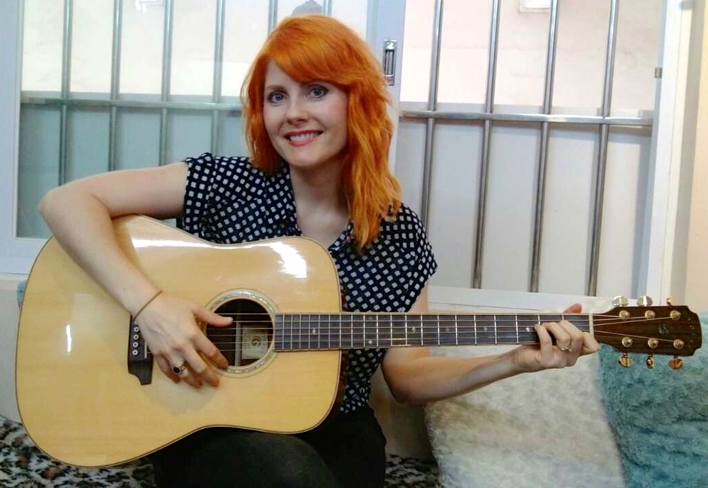 Orange Hair Smile w Guitar.JPG