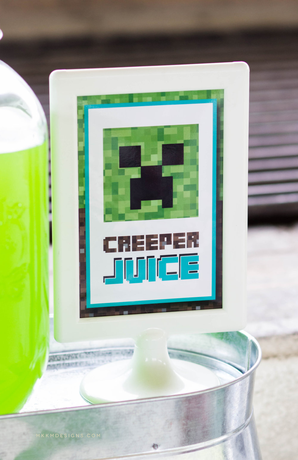"Minecraft ""Creeper Juice"" sign by MKKM Designs. Find the free printable at http://www.shopmkkm.com/blog/2017/minecraft-party-planning"