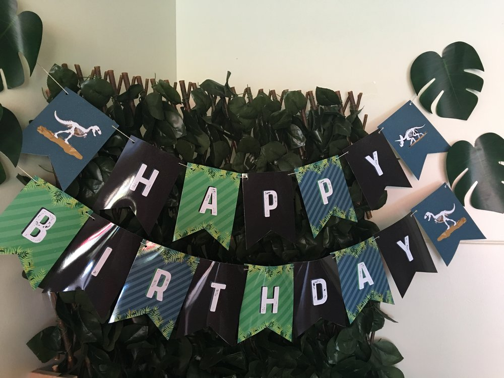 Happy birthday banner for a dinosaur birthday party by MKKM Designs