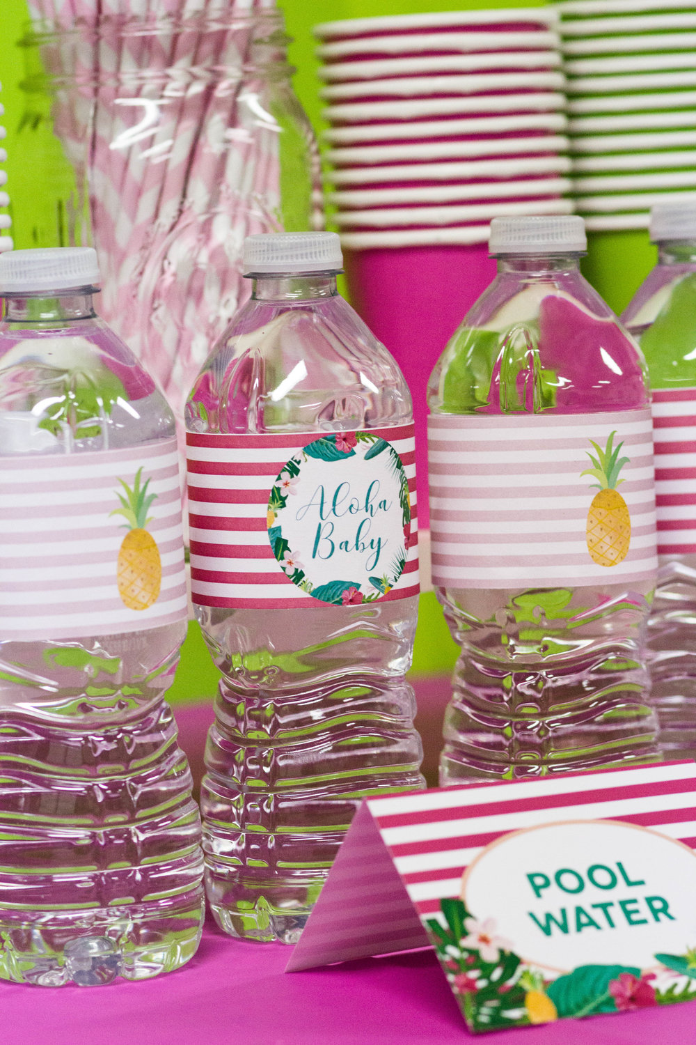 Flamingo bottle wrappers from a flamingo themed baby shower // designs from shopmkkm.com