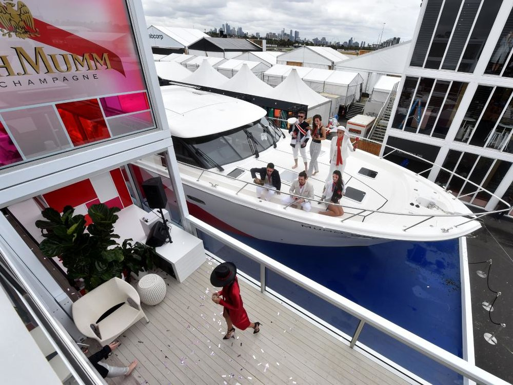 G.H Mumm certainly made a splash at this years Emirates Melbourne Cup! Image via The Australian