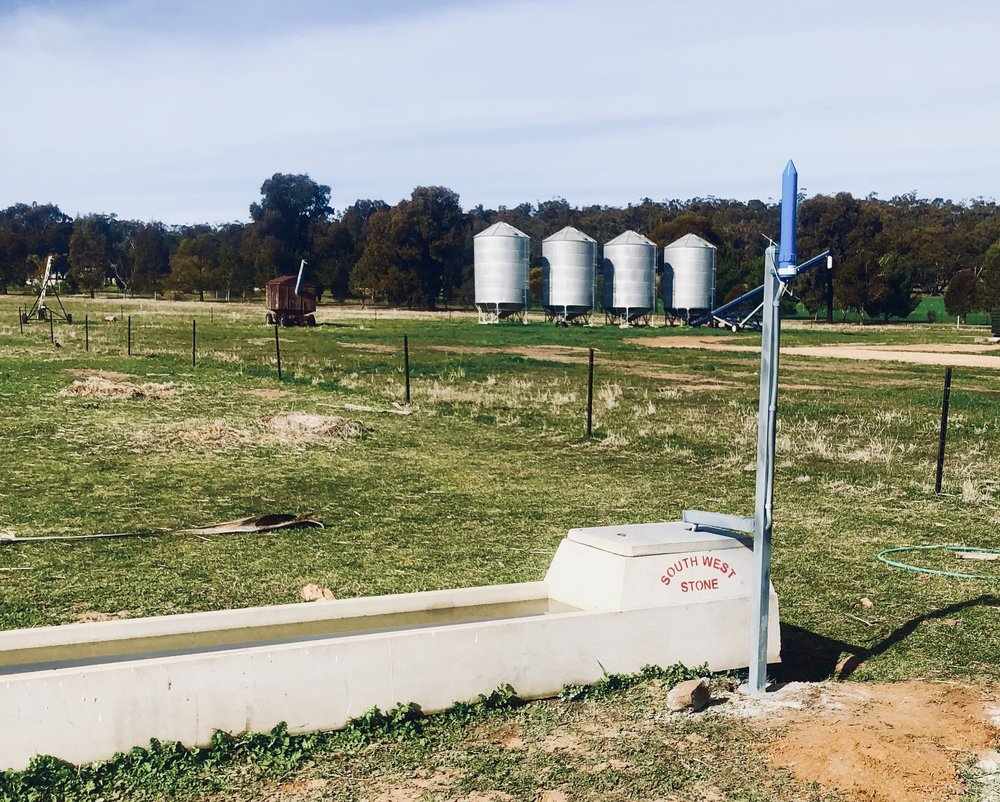 No, this farmer isn't letting off a small rocket - that little blue spaceship looking device is keeping an eye on the trough so he doesn't have to.