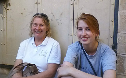Camp co-director Margret and intern Kate take a seat in the Old City Market.