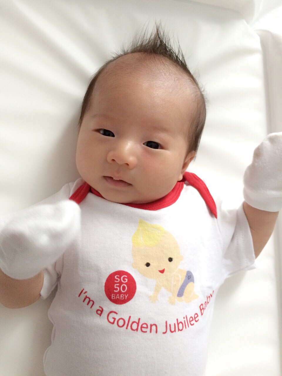 Lil X at 2months old! Dont you think he looks like the SG50 baby? Must be the hair... Haha!