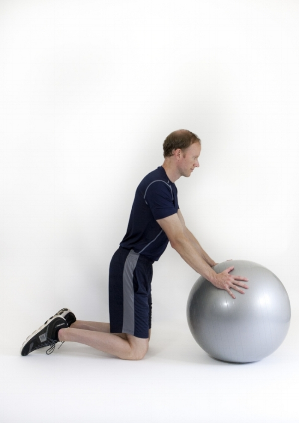 Advanced stability-ball push-up: start position.