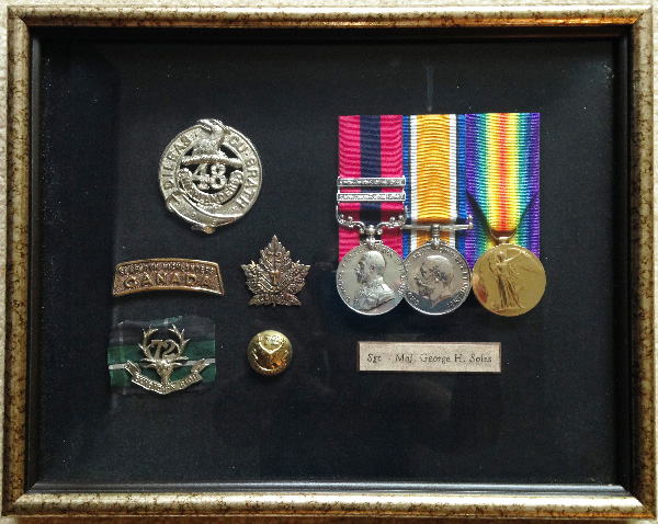 CSM George H Soles' DCM with two bars is the left-most medal, with the blue and red ribbon.