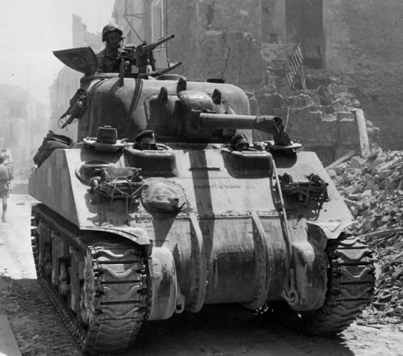 A Canadian tank rumbles through the old-world streets of Regalbuto.