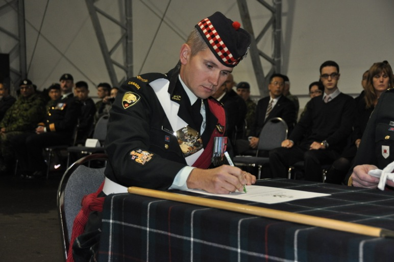 CWO Gormley signing the Change of Appointment scroll