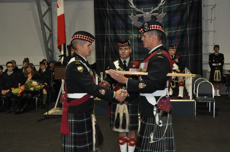CWO Gormley to CWO O'Connor shake hands after the formal handing over of the RSMs pace stick. The pace stick has been both a tool used in drill, and a badge of office of Regimental and Company Sergeants Major.  Originating in the Artillery, it was used to align and space out artillery pieces in a gun line, but was soon taken by the Infantry for similar purposes, but with formed bodies of soldiers as opposed to guns.  It is also a handy tool for emphasizing a point.  The RSM is rarely without his pace stick, and is easily recognizable from a distance because of it.