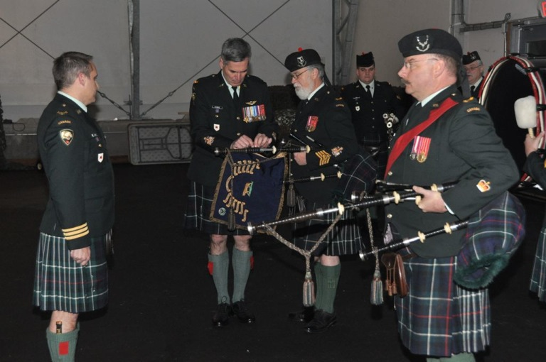 The final ceremony of the evening saw the symbolic passing of the CO's Pipe Banner from the retiring Pipe Major, CWO Mike Bain (background), to the newly appointed Pipe Major, WO Vern Kennedy (foreground). CWO Bain has served the regiment with distinction for over forty years and will continue to make his presence felt as he goes on to mentor young pipers and drummers with the various Seaforth Cadet Corps as part of the COATS program.