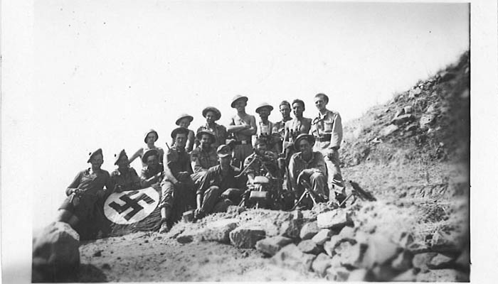 Seaforth A Coy in the Salso Valley, Sicily - August 1943. The Seaforths have posed with the German soldiers that they just captured. Note their MG-34 machine gun and Nazi flag.