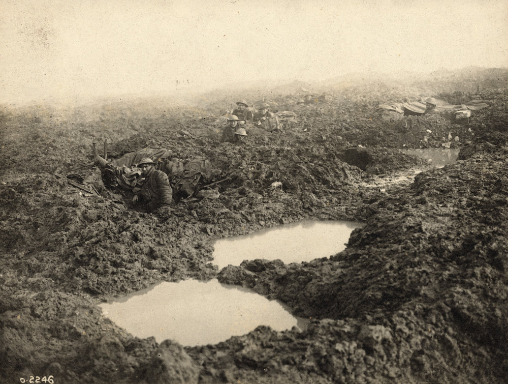 Soldiers carried 70-pound packs through water-filled shell-holes, putrid trenches and fields of clinging mud.