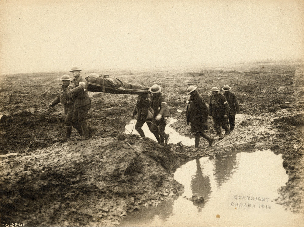 Carrying the wounded required four to six soldiers to navigate through the muck and shell-holes.