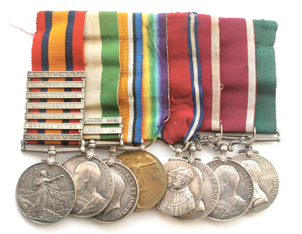 Pipe-Major John Gillies' Medal Group: Queen's South Africa Medal, with bars for Belfast, Diamond Hill, Johannesburg, Driefontein, Paardeberg, Modder River, Belmont; King's South Africa Medal, with bars for 1901 and 1902; British War Medal; Victory Medal; King George V Silver Jubilee Medal; Meritorious Service Medal; British Regular Army Long Service and Good Conduct Medal; Colonial Long Service Medal.