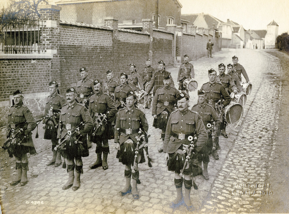 The pipe band of the 72nd Seaforth Highlanders of Canada during the First World War. Pipe-Major John Gilles can be seen at the far left.