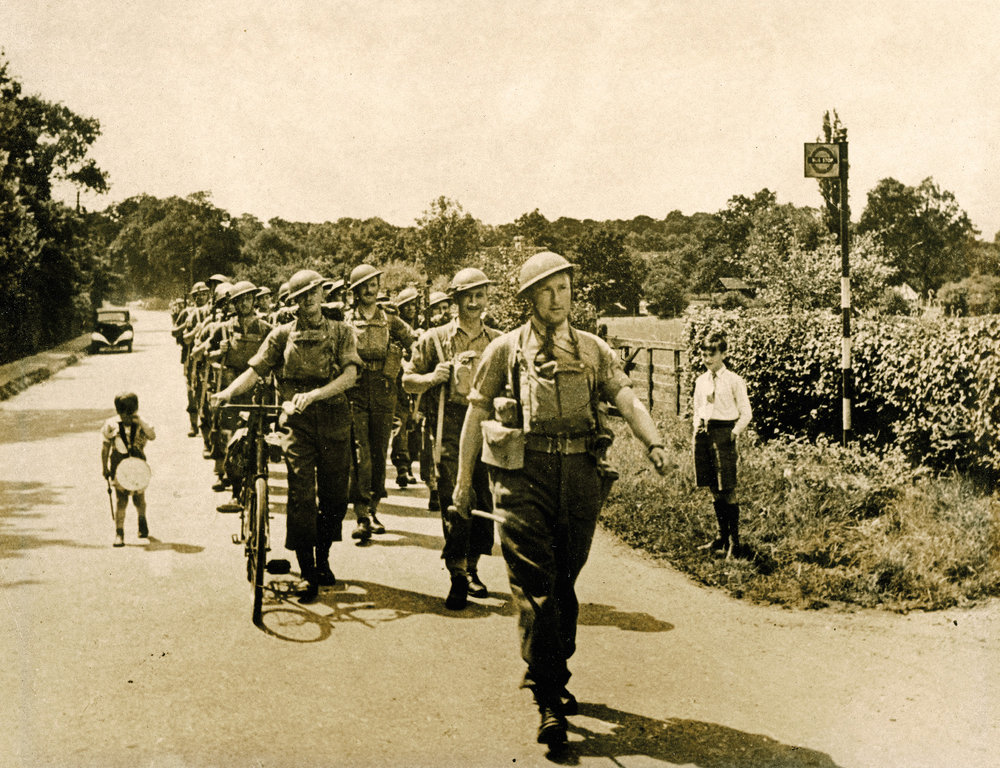1939-1943: Training in England. Major Hoffmeister leads B Company (sans drummer-boy) on a route march near the village of Limpsfield in the summer of 1940.