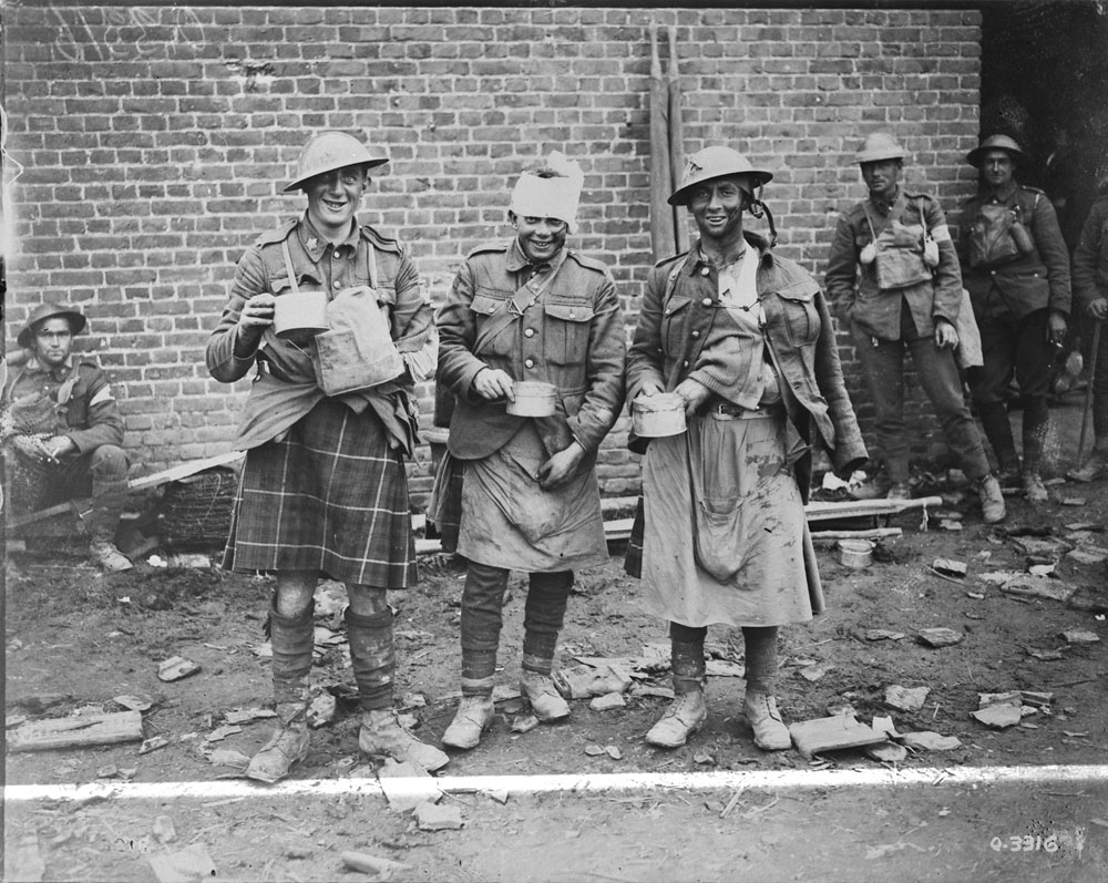 Three 'walking wounded' members of the 72nd Battalion, Seaforth Highlanders of Canada, in October 1918, east of Arras. The two chaps on the right are wearing full kilt aprons.