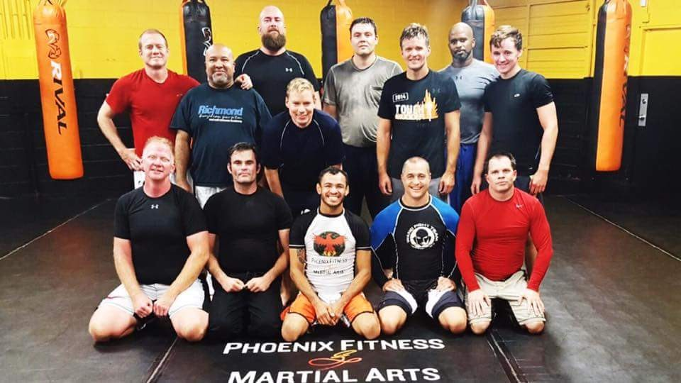First Jiu-Jitsu Class: David, our instructor, middle of first row. Ethan is the next guy to the right.