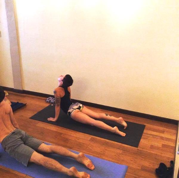 Ashtanga Yoga practitioners in yoga pants and short yoga shorts.