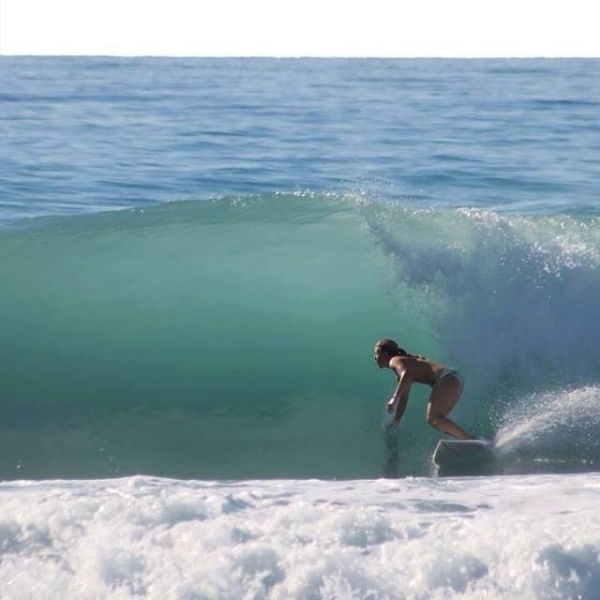 Our own Courtney Wolfgang is also an avid surfer, an activity she enjoys and has practiced for many years.