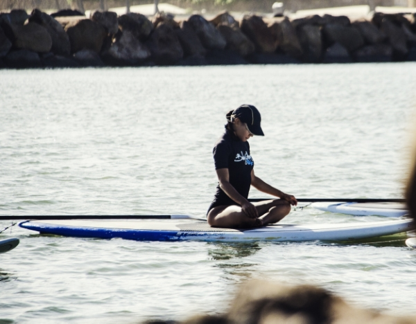 The time I tried SUP Yoga:being on the water brings a heighten sense of attention to the body, especially to the core muscles. At one point the teacher had us place one hand in the water and feel the energy(pull) of the ocean.This also happens within us. Photo Credit: Christian Bettelli