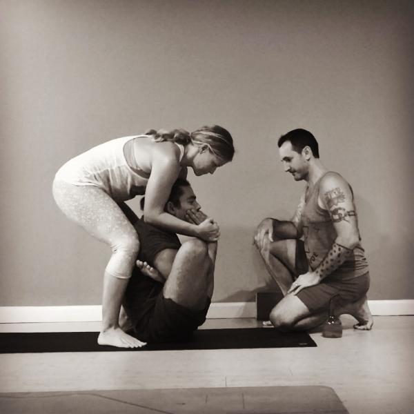 Learning to assist Garbha Pindasana with Greg and Juan Carlos of Ashtanga Yoga Worldwide