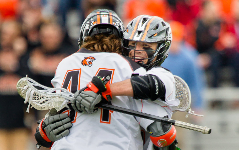 Lee (right) hugs Levick after Levick scores in the NCAA second round.