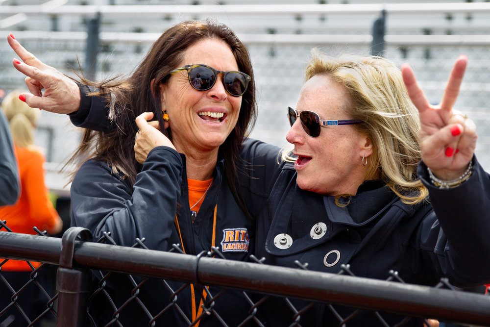 "Ryan's mother, Leah Lee (left), and Chad's mother, Lynda Levick, celebrate after the boys won the NCAA Semifinal game to advance to the national championship. Lynda cheered, ""Dynamic Duo"" as the boys came off the field."