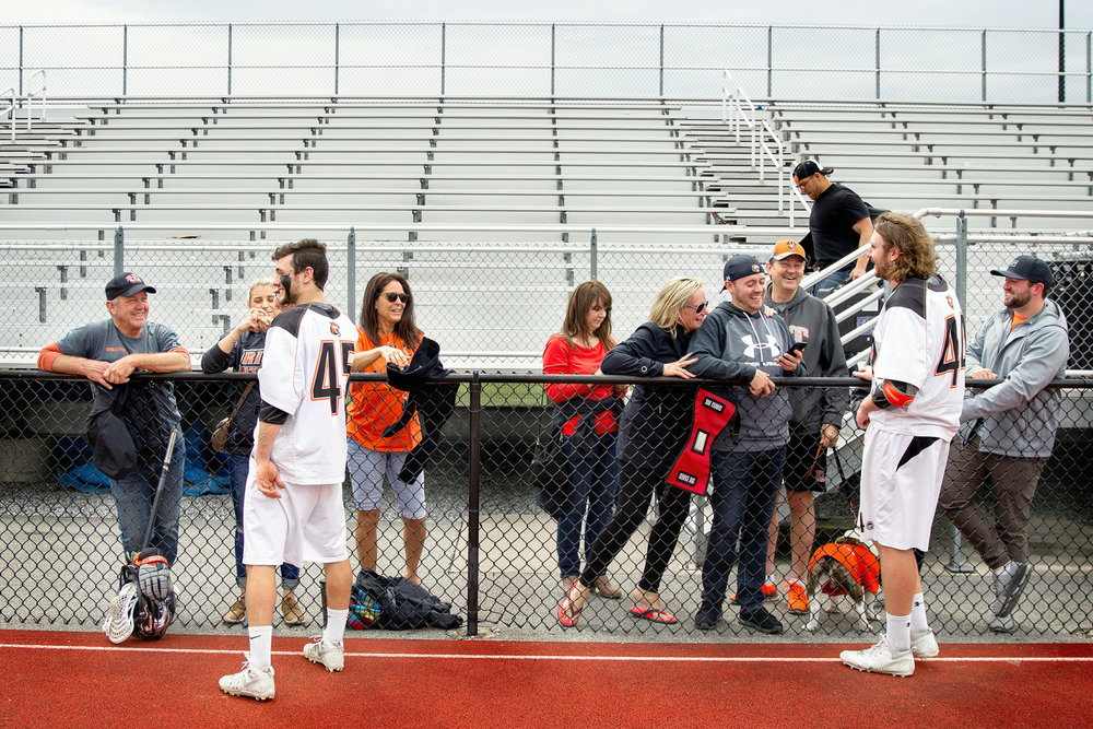The Lees (left) and Levicks interact after RIT defeats Wesleyan University 22-9 to advance to the NCAA Championship game at Gillette Stadium in Boston, MA.