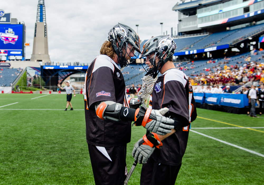 The duo takes a moment together before stepping onto the field for the biggest game of their careers.