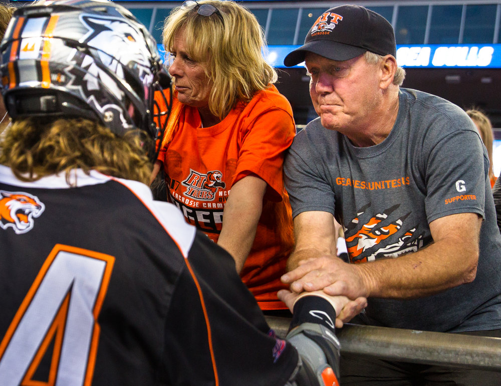 Lee's father, Tim (right), takes a moment with Levick after RIT's loss.