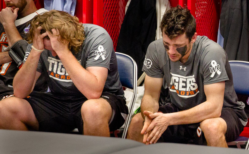 Levick (left) and Lee sit next to each other in silence, after facing defeat in the NCAA Championship game.