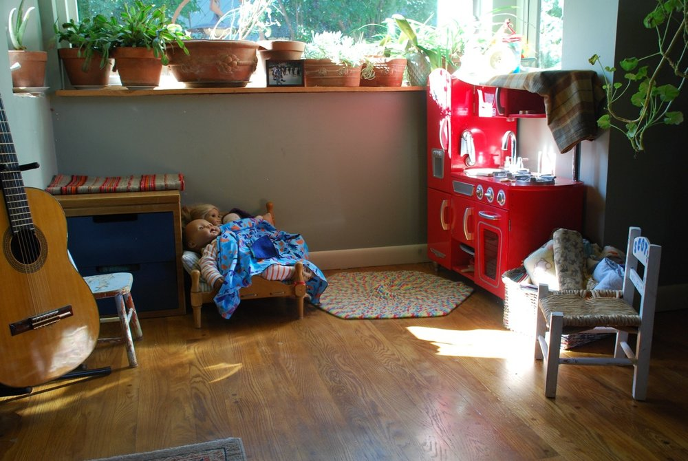 A kid's nook with sunshine and plants.