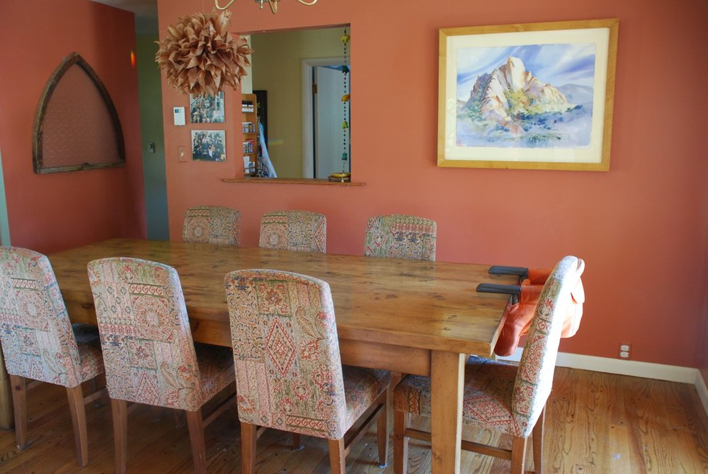Dining room with the original painting that I adore. The image has a triangular mountain shape that enhances the 3 pointed Fire energy of the External Recognition area where it now lives.