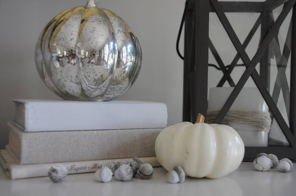 books, used book store $.50- $3.00 + acorns, Target dollar bin last year- sprayed white + pumpkin, Marshalls $3.99 + lantern, $12.99 Marshalls + mercury glass pumpkin $9.99