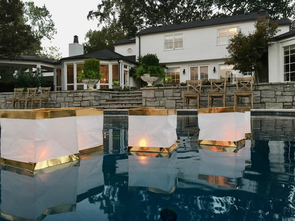 White and Gold Floating lanterns in Pool
