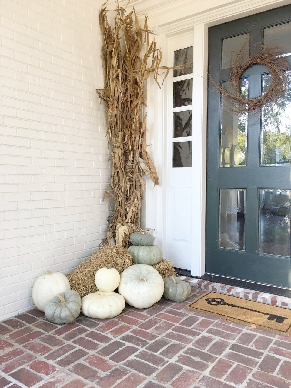 Fall Front Porch Decorations with green, gray and white pumpkins