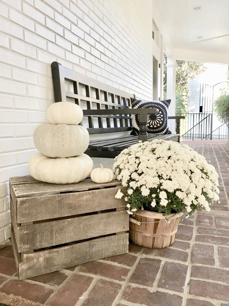 Fall Porch Decorations on Breezeway White pumpkin stack on wooden crates