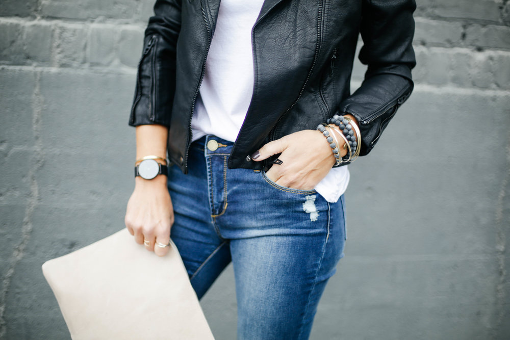 leather jacket with clutch.jpg