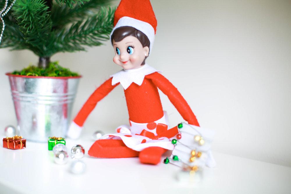 close up of girl elf at christmas tree.jpg