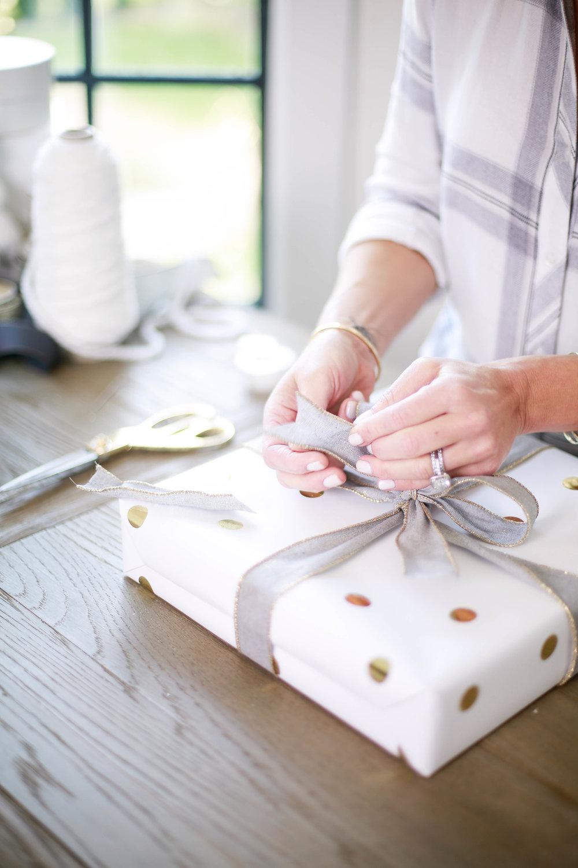 Landyn wrapping gift.jpg