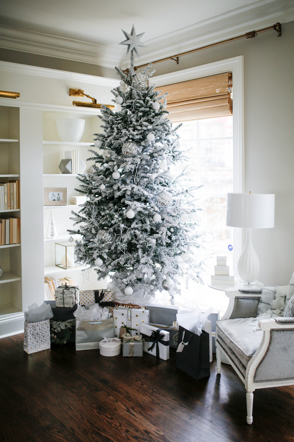 White flocked Christmas tree with white and silver ornaments, a modern christmas tree