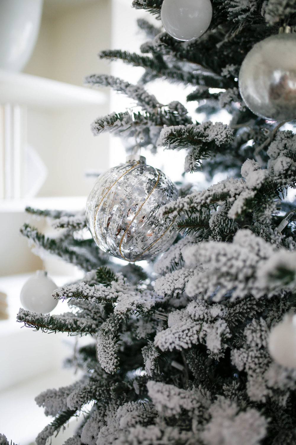 Silver and White Ball ornaments on flocked Christmas Tree