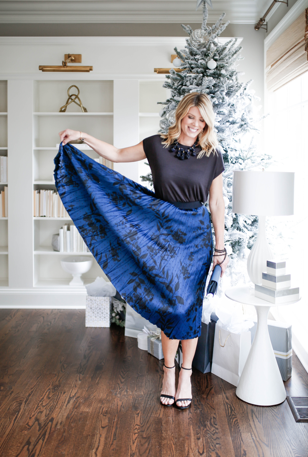 what to wear to an office christmas party, printed floral pleated midi skirt